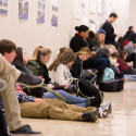 students sitting in hall waiting for class to begin